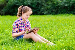 Girl playing on tablet.jpg